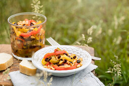 Pepper salad with pine nuts and currants