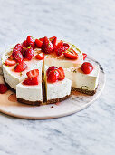 Lime Cheesecake with Coconut Crust, Strawberries and Passionfruit Sauce
