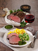 Roast beef in a pepper crust with ribbon noodles