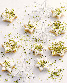 Star cookies with icing and pistachios