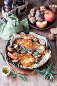 Pork chops with jerusalem artichokes, apples and sage