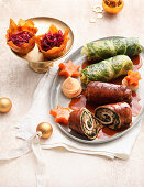 Veal rolls and savoy cabbage rolls with red cabbage baskets