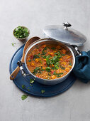 Indian vegan lentil stew with sweet potatoes and spinach