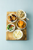 Toppings for salads - vegetable chips, cashew nuts, bread chips, parmesan
