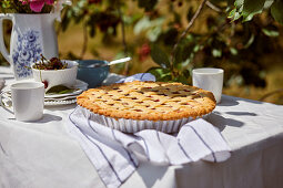 Cherry pie served outside on the table