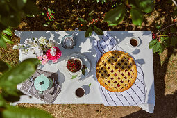 Coffee and cherry pie served outside on the table