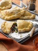 Spicy spinach pockets with ricotta and dried tomatoes