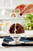 Christmas pudding with vanilla sauce