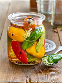 Pickled red and yellow pepper with white cabbage