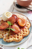 Waffles with roast plums and vanilla ice cream