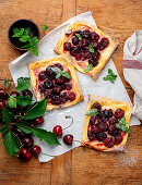 Vanilla and cherry wedges with mint