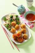 Asian carrot and tofu balls with broccoli rice and sweet chili sauce