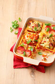 Sandwich lasagna with cheese, ham, and sausage