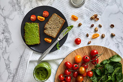 Homemade basil and arugula pesto on a piece of bread