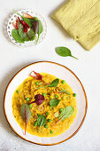 Saffron risotto with fontina, peas and herbs