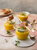 Mango-and-carrot soup with scallop skewers