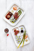 Bentobox Sushi platters with green asparagus and soy sauce