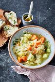Sauerkraut-celery stew with raclette crostini