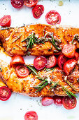 Salmon from the oven with cherry tomatoes and rosemary