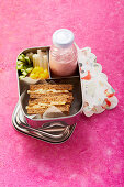 Banana and peanut sandwiches with a raspberry shake 'To Go'