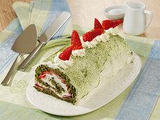 Green matcha sponge roll with a strawberry mascarpone filling