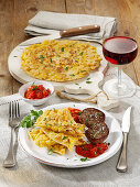 Corn pancakes with seared beef steaks and tomato sauce