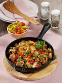 Fried minced meat and potatoes with peppers