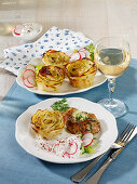 Roasted turkey medallions with potato roses and a radish dip