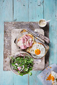 Croque Madame and Croque Monsieur with rocket salad