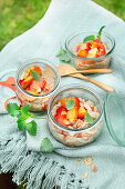 Vegan risotto substitute with almond drink, strawberries and peaches