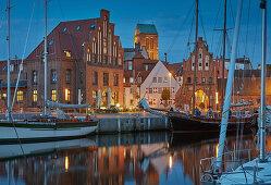 Wismar, old harbor with church St. Nikolai, Wassertor and Zollhaus, Mecklenburg Vorpommern, Germany