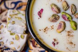 Iranian gaz and ricepudding fereni with pistachios, Iran, Asien