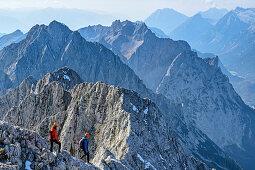 Two women descending from Woerner, Karwendel range in background, Woerner, Karwendel range, Upper Bavaria, Bavaria, Germany