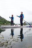 Stand up paddle boarding at Loch Duich, Eilean Donan Castle, Dornie, Highlands