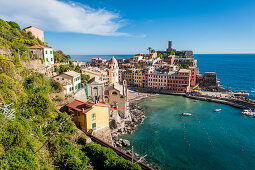 View from above of the vineyards down to the port of Vernazza, Cinque Terre, Italy