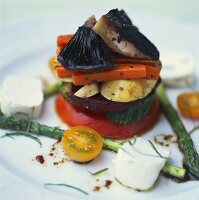 Vegetable tower with goat's cheese and strips of basil
