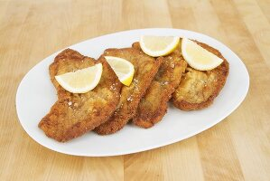 Veal escalope with lemon wedges