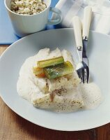 Steamed halibut with black tea and fried leeks