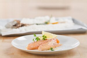 Salmon trout in salt crust
