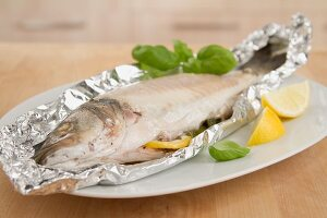 Sea bass cooked in aluminum foil