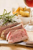 Fillet steak with rosemary, roast potatoes, glass of wine