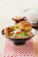 Curried meatballs with vegetables in coconut sauce