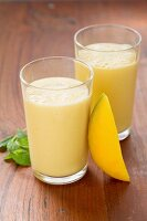 Two glasses of mango lassi