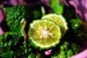 Kaffir limes, whole and halved