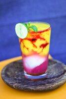 Vitamin juice made from papaya, watermelon, pineapple, cherries and coconut water