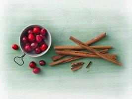 Cinnamon sticks and cranberries