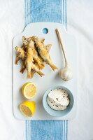 Fried sardines with garlic aioli and lemon