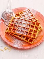 Almond waffles with icing sugar