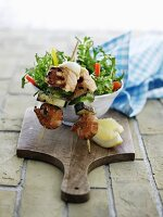 Grilled prawns, salmon and vegetables served with salad