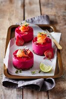 Mini beetroot cheesecakes with salmon and pumpernickel bases
